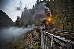 Railroad Art - Hauling though the mountains  by Patrick  Flynn