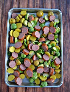 Kielbasa and Potato Sheet Pan Supper - - A delicious one pan meal made with kielbasa, potatoes, and Brussels Sprouts. Kielbasa And Potatoes, Oven Roasted Potatoes, Chicken And Cabbage, Cooked Cabbage, Supper Recipes, Entree Recipes, Brussel Sprouts In Oven, Roasted Radishes, Sheet Pan Suppers