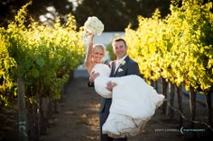 A bride and groom taking advantage of our beautiful vines for a photo opportunity!  Plan your wedding at Chateau Julien!  http://www.chateaujulien.com/meeting-events-venues/planning-your-event