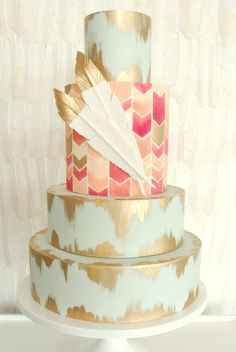 beautiful hand painted chevron and gold wedding cakes