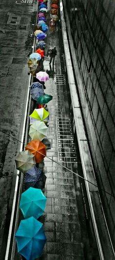 Colorful umbrellas. Great rain photography!