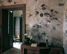 A floral wall mural by the painter Claire Basler in her home, Château de Beauvoir, in France