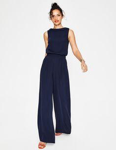Floaty and flattering, it's no wonder this jumpsuit is so popular. The fitted waist flares out to sophisticated palazzo legs, and we've also snuck in pockets concealed by the front pleats. The high neck and roll collar detail keep things comfortable and easy, so all you have to worry about is which colour to choose.
