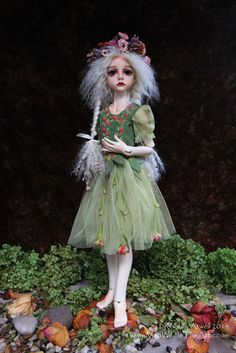 """Dollstown Seola on elf body.  She is fresh skin resin. I painted her face, blushed her body, and made her wig.  She is wearing a dress made by the Kish company and I """"antiqued"""" it with paint."""