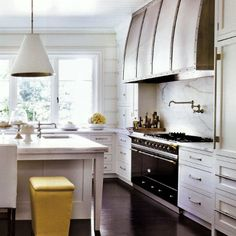 love this classic white and marble kitchen and the hardware