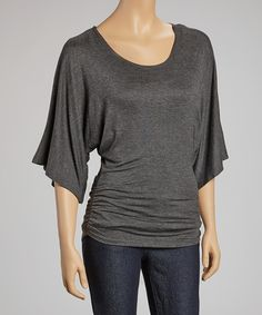 This luxe top is sure to bring ease and comfort to any wardrobe. Delicate side ruching and a solid hue add class to any couture outfit.Measurements (size S): 29'' long from high point of shoulder to hem50% polyester / 50% rayonHand wash; dry flatMade in the USA