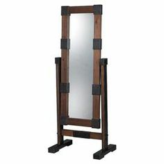 """Floor mirror with riveted iron details and a wood frame.   Product: Floor mirrorConstruction Material: Wood, iron and mirrored glassColor: BlackDimensions:  67"""" H x 17.5"""" W x 26.75"""" D"""