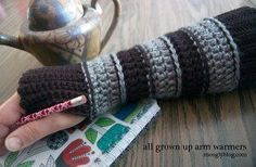 The free crochet pattern for these All Grown Up Arm Warmers are offered in two sizes. They're great for layering during the fall and winter season and they're perfect to wear in cold offices.