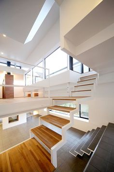middle stairway section of an 8-leveled, stark white, steel-structured house in Senri