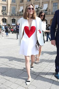 July 3, 2017 - Olivia Palermo is wearing a V-neck mini with heart motif on the front from Schiaparelli's SS17 collection.