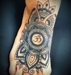 Too dope. Blooming Lotus flower surrounded by symbols, with the Om for the center...
