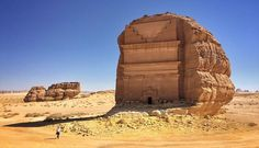 Carved into a massive boulder, Qasr al Farid, or The Lonely Castle, is a stunning ancient tomb rivaling the majesty of any carved architecture in the world. Abandoned Buildings, Abandoned Places, Monuments, Ancient Tomb, Ancient Ruins, Beau Site, Site Archéologique, Archaeological Site, Saudi Arabia