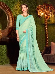 Indian Women Cyan Color Jacquard Exclusive Party Wear Saree Bring out the best in you when wearing this cyan color imported coated fabrics and imported net jacquard fabrics and heavy sparkal sheet in border saree. Ideal for party, festive & social gatheri Indian Designer Sarees, Designer Sarees Online, Indian Sarees, Satin Saree, Silk Satin, Silk Sarees, Party Fashion, Look Fashion, Fashion Outfits