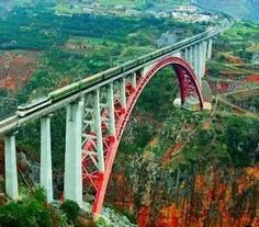 Beipanjiang River Railroad Bridge, Guizhou, China!!  Beipanjiang River Railroad Bridge in Guizhou is an enormous railway bridge that was built as    Part of the Guizhou-Shuibai Railway Project. Connecting two mountains over a deep ravine,    At its highest point, the bridges deck sits 918 ft above the ground.    Parenthetically the bridge in Guizhou connects two of the countryspoorest areas.