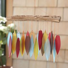 Sea-glass Wind Chime  Handcrafted in Bali, the genuine sea glass pieces in this set of chimes make the most soothing sound. Strung with clear wire from the monkey wood hanger, the glass reflects light and moves gently in the wind creating a perfect ambiance for your outdoor or indoor space.  From Stonewall Kitchen $27.95