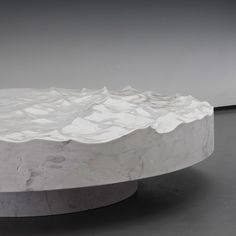 Mathieu Lehanneurchipped blocks of marble and bronzeto create tables, benches and stools that resemble the surface of the ocean.