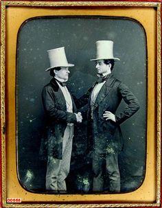ca. 1850's, [daguerreotype portrait of two gentlemen in white beaver fur hats posed, shaking hands]