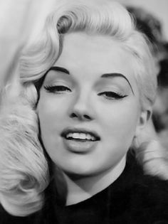 Jane Mansfield - I am not sure if she or Marilyn were the better looking one. In some pictures they kinda look like twins.