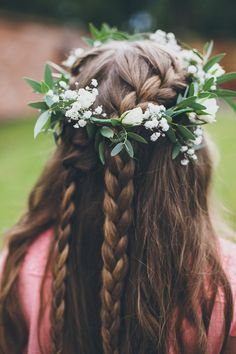 These braids look lovely with the flower crown! Image by @matthoran85 #wedding #bride #romantic #vintage