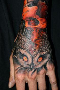 Jeff Gogue  black owl orange skull tattoo on hand