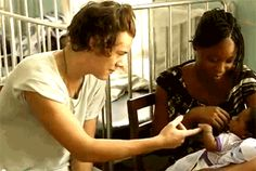 """Pin for Later: You're Never Too Old to Start Crushing On Harry Styles He's Good With Kids Cue the """"Awws!"""""""