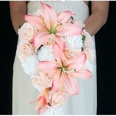 Make a statement with your bridal bouquet. We are in love with this gorgeous lily and rose bouquet designed by Budget-Bride #fauxflowers