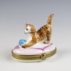 Vintage hand painted porcelain trinket box with orange and black tabby cat playing with a ball by Limoges, France