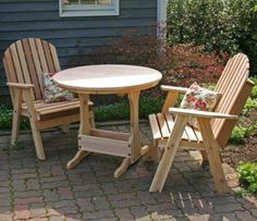 """Cedar Fanback Bistro Set (Natural) (41.5""""H x 28.5""""W x 25""""D) by Creekvine Designs. $949.00. The wood bistro set includes two fanback dining chairs and a round bistro patio table. Color: Natural. If left unstained / unsealed, the cedar will weather to a silver / gray patina look and will. Size: 41.5""""H x 28.5""""W x 25""""D. Rounded and sanded edges will keep legs and hems safe without fear of snagging. Ditch the expensive coffee houses and lunch spots for your very own ..."""