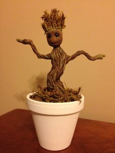 Dancing Baby Groot. Made with air dry clay, some moss, paints and a LOT of time and patience ^_^