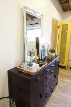 I love the tray, and plant and mirror and photos and books // Remodelaholic | Styling My Dresser: Before and After