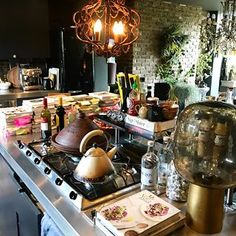 A peek into my kitchen... lots of cookbooks, onions and vino #interiordesign #interiors