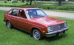 In 1980 we bought this 4 door Chevette. We had a toddler and it was much easier to place him in his car seat with 4 doors. It was orange and was a 4 cylinder 4 speed without A/C.