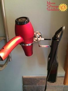 Hair dryer and flat iron holder for wall, to get these items off your bathroom counter {featured on Home Storage Solutions 101, plus 9+ other hair appliance holder ideas}