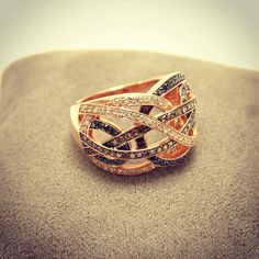 Black, chocolate and white diamonds set in rose gold #SJJewelers #SmokinJoesJewelry  #diamond #ring