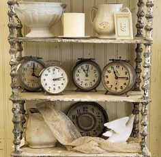 vintage clocks, I have something like this in my house all set to the time of my childrens births....