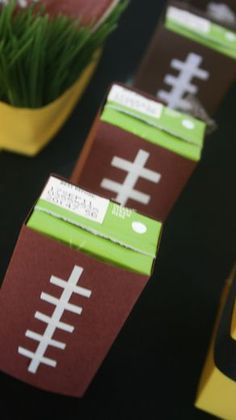 Juice boxes covered in cardstock to look like footballs. Little touches like this can have a big impact on your football parties!