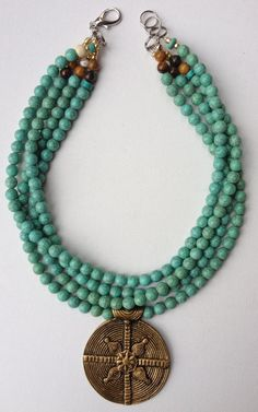 Ravi necklace - turquoise howlite bead neckalce with solid brass Naga tribal pendant