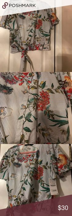 Zara Floral Top Never worn - tags still attached. Front button closure detail with bow at the waist. Zara Tops Blouses
