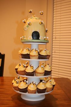 I made the bees out of fondant then used floral wire to put then in the cupcakes. I didn't do the hive on top Bee Cupcakes, Cupcake Cakes, Cupcake Wrappers, Beautiful Cakes, Amazing Cakes, Bee Party, Love Cake, Creative Cakes, Mini Cakes