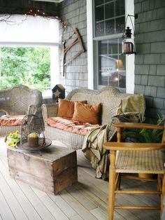 Rustic Porch...weathered wood, shabby wicker, rocker, candles in rusty wire, & pillows...relax.