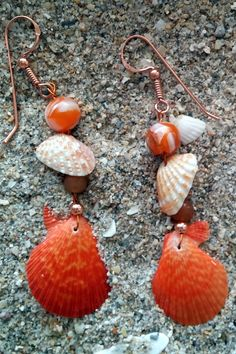 Copper ear wires. Rough scallop, cardith, composite bead, and copper ball on amber wire. WE02 $15 Can be worn with WN16