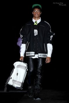 Jameson Butler wearing rubber sports jacket, signature logo t-shirt by designer Marion G. Boyd for Upfront Urban Street Style, LLC. Fall/Winter 2014 collection.