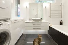 This Camberwell Bathroom renovation makes efficient use of every inch! A tranquil bathing area combined with a functional laundry, this space was designed and built by John Perini.
