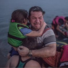 #repost #thecoolhunter #tragic #cantimagine #we turned our backs on you ....Syrian man with his children trying to find safe haven from a war torn country only to meet attackers in neighboring lands