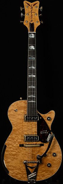 Tonal Evaluation This ferocious flamed maple monster is one of my favorite masterbuilt Gretsches I've ever played! This serial has huge, booming low end, a slight scoop in the mdis, and some serious snarl in the treble. The neck pickup sounds like what would happen if a subwoofer had a baby with...