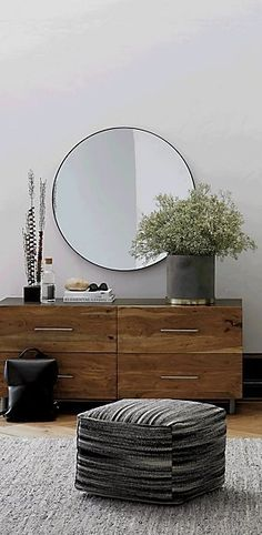 "Minimal reflections. Looking glass framed thin, trim and exact in pure extruded aluminum with matte black finish. Handmade frame resists corrosion so it's perfect in the bath. Infinity Black Round Wall Mirror 36"" is a CB2 exclusive."