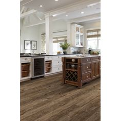 Add contrast to all white kitchen décor with our Downs Shaw Harvest flooring. The grainy rustic tones are a perfect balance to light and airy cabinets. Try this today for an overall farmhouse feel! White Kitchen Decor, All White Kitchen, Kitchen Colors, Kitchen Design, Rustic Wood Floors, Hardwood Floors, Flooring, Open Kitchen Cabinets, Dark Cabinets