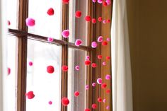 Holiday Window Garland - pick up some pom poms in various sizes and threaded them on lengths of some transparent thread.  Just tied a knot in the bottom and threaded the pom poms on with a needle and tried to evenly space them.  Then I taped each strand to the trim at the top of the window (not fancy I know, but it works and itll only be up for a little bit anyway).