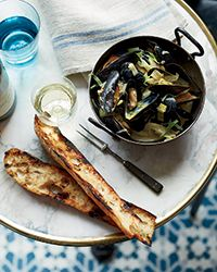 Mussels with Caramelized Fennel and Leeks - A simple mussel broth, caramelized vegetables and a dollop of crème fraîche all pump up the flavor of these Bistro worthy  steamed mussels| Food & Wine