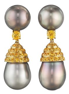 A Pair of Cultured Pearl and Yellow Sapphire Ear Pendants by Verdura. Each suspending a cultured baroque pearl, measuring approximately 14.00 mm, from a pavé-set yellow sapphire cap to the circular-cut yellow sapphire spacer and cultured-pearl surmount, mounted in 18K yellow gold, length 1 3/4 inches. Signed 'Verdura'.